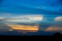 Silhouette antenna with twilight sky. Silhouette of telecommunication pole,antenna with twilight sky and rainbow cloud Royalty Free Stock Photography
