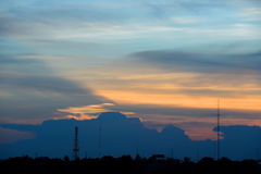 Silhouette antenna with twilight sky. Silhouette of telecommunication pole,antenna with twilight sky and rainbow cloud Stock Photography