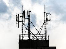 Silhouette of antennas. On top of building with cloud sky in Sao Paulo city stock photography