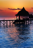 Silhouettearbor over water for rest at sunset. Sea tropical landscape Stock Photos