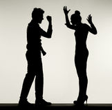 Silhouette of arguing couple Stock Image