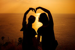 Silhouette arm in heart shape Stock Photography