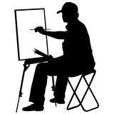 Silhouette, artist at work on a white background, Stock Image