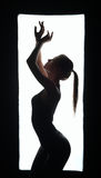 Silhouette of artistic dancer in frame Stock Photography