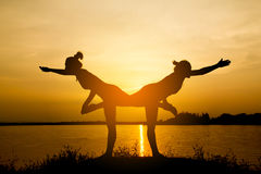 Silhouette Asia woman yoga Stock Image