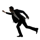 Silhouette of Asian business man running Stock Images