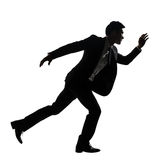 Silhouette of Asian business man running Royalty Free Stock Photos