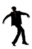 Silhouette of Asian businessman dancing Royalty Free Stock Image