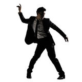 Silhouette of Asian businessman dancing or posing Royalty Free Stock Photo