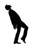 Silhouette of Asian businessman dancing or posing Stock Photo
