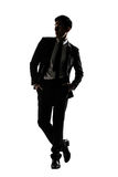 Silhouette of Asian businessman dancing or posing Stock Image