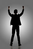 Silhouette of Asian businessman open arms Royalty Free Stock Photos