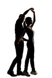Silhouette of Asian couple dancing Stock Image