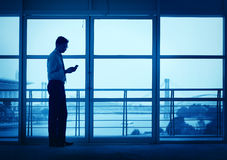 Silhouette of Asian Indian man texting stock photo