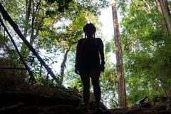 Silhouette of Asian woman adventurer is standing in front of the Pu Wai cave Stock Images