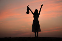 Silhouette of asian woman play violin Royalty Free Stock Photo