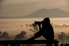 Silhouette asian women photography take a photo with beautiful s Royalty Free Stock Image