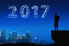 Silhouette asian young man with bright star on a 2017 Stock Photos
