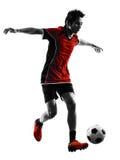 Silhouette asiatique de jeune homme de footballeur Image stock