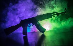 Silhouette of assault riffle on toned foggy background. War concept. Russian military weapon on table. Selective focus. Silhouette of assault rifle on toned Royalty Free Stock Image