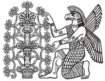 The silhouette of the Assyrian deity collects fruits from a fantastic tree. Stock Photos