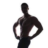 Silhouette of athlete bodybuilder man Stock Images