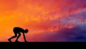 Silhouette of athlete in position to run stock photography