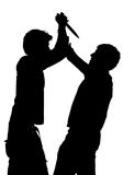 Silhouette of an attack with a knife Stock Images