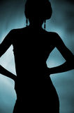 Silhouette of attractive slim woman Stock Photography