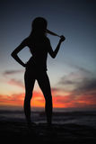 Silhouette of attractive woman on sea background Stock Image