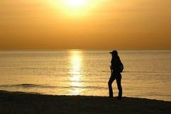 Silhouette au coucher du soleil Photos stock