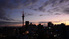 Silhouette of Auckland skyline at sunrise stock footage