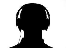 Silhouette av ett huvud med hörlurar Arkivbilder