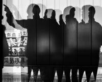 Silhouette av folk Arkivfoto
