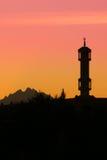 Silhouette av moskén Fotografering för Bildbyråer