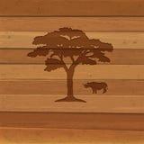 Silhouette av noshörningen och treen på träbakgrund Fotografering för Bildbyråer