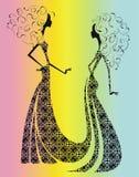 Silhouette av två härliga flickor. Royaltyfria Foton