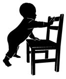 Silhouette babe and chair. Child silhouette holding on to a chair Royalty Free Stock Photo