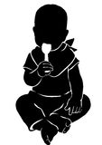 Silhouette babe with spoon. Silhouette of kid licking the spoon Royalty Free Stock Photography