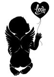 Silhouette baby angel with balloon love. Silhouette baby angel with text `love` on balloon Royalty Free Stock Photography