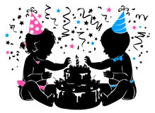 Silhouette baby boy girl twins with birthday cake with candle Royalty Free Stock Image