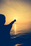 Silhouette back view of woman relax at seaside and pointing to t Stock Image