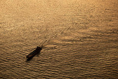 Silhouette Background  of a boat is running through a river in th Stock Photography