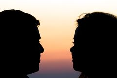 Silhouette background of romantic couple Stock Photos