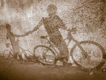 Silhouette background, shadow of two biker holding hands. On the wall Royalty Free Stock Images
