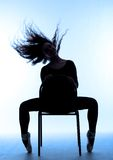 Silhouette of ballerina on blue Stock Images