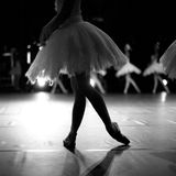 Silhouette of ballerina dancing. Ballerina's graceful legs onstage, monochrome Stock Images
