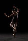 Silhouette ballet dancer in black swimsuit Royalty Free Stock Image