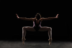 Silhouette ballet dancer in black swimsuit Stock Images