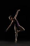 Silhouette ballet dancer in black swimsuit Stock Photo
